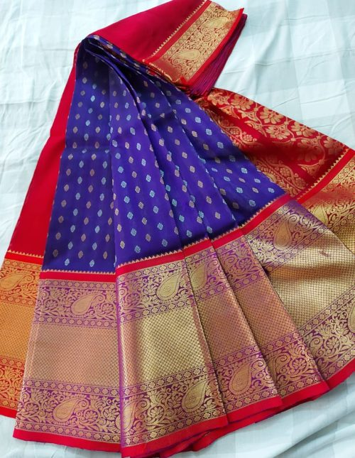 Kuppadam blue and red kanchi border saree