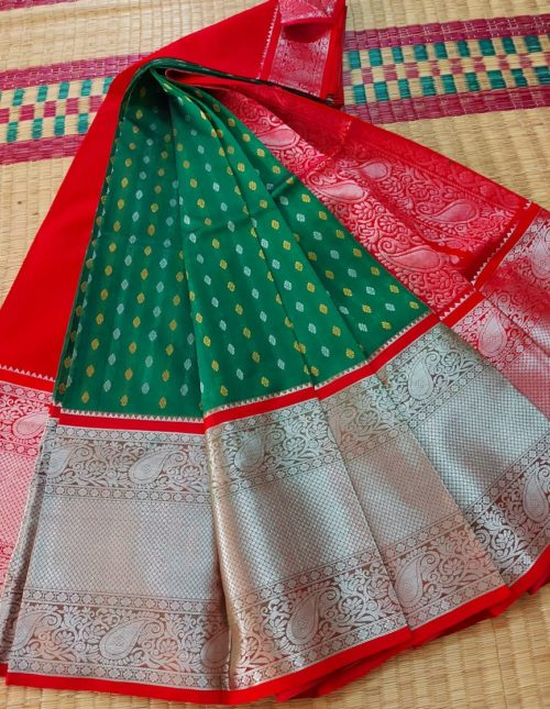 Green and red kuppadam pattu saree with silver kanchi border